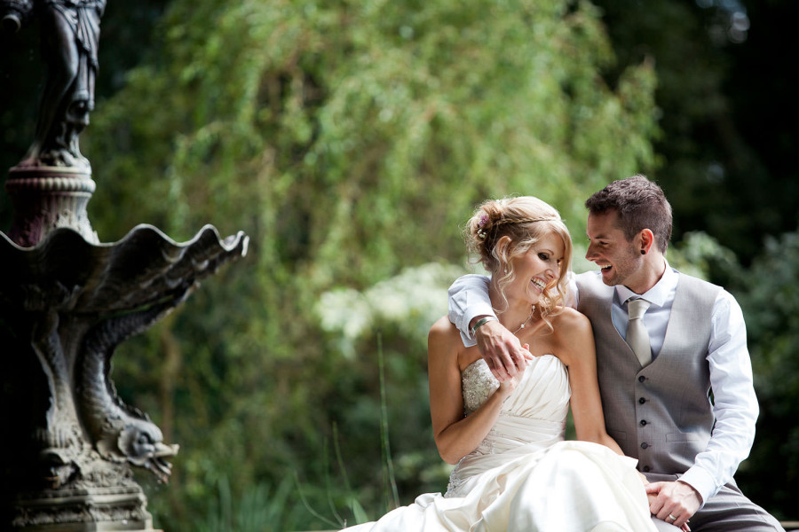 Delightful Couple Sharing A Laugh On Their Wedding Day In The Midlands